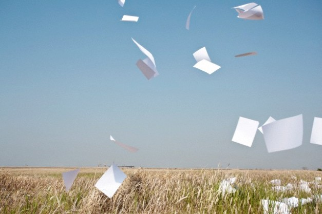 Paper Flying in Mid Air --- Image by Sung-Il Kim/Corbis